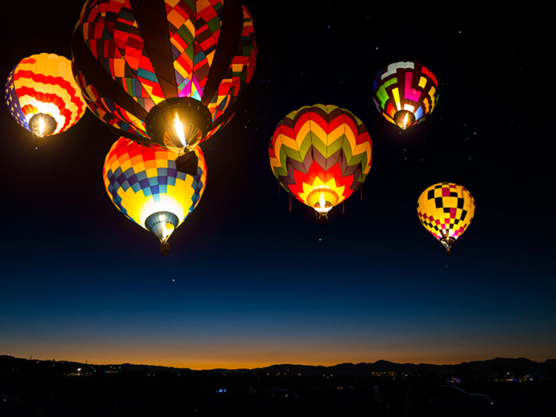 Photo: Hot Air Balloons Lit up at Night (Albuquerque)